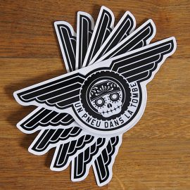 """Sticker """"UPDLT"""" - Boutique """"Un pneu dans la tombe""""."""